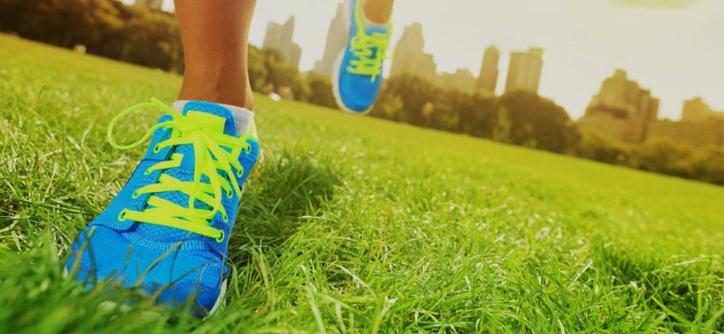Running shoes on grass